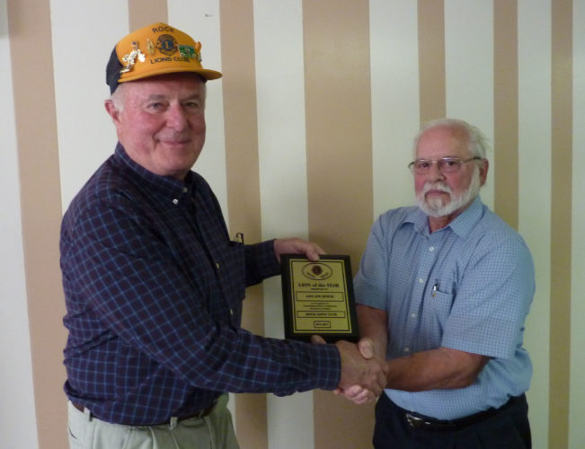 Courtesy photo Rock Lions President John Stams presented the Lion of the Year award to out-going president Joe Kitiuk. The Lion of the Year is chosen by the membership and is awarded to a member who has performed outstanding service throughout the year.
