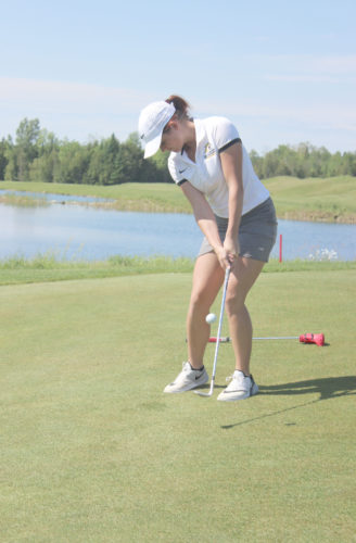 Dennis Grall photo Carol Els, a sophomore on the Northern Michigan University women's golf team, chips to the ninth green at Sweetgrass Golf Club. Els, from Namibia, South Africa, will compete in the Symetra Tour's Island Resort Championship at Sweetgrass next week.