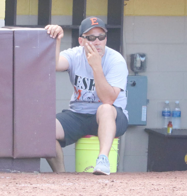 Photo by Tim Robinson Escanaba coach Jamie Segorski in the top of the seventh inning in Tuesday's quarterfinal win.