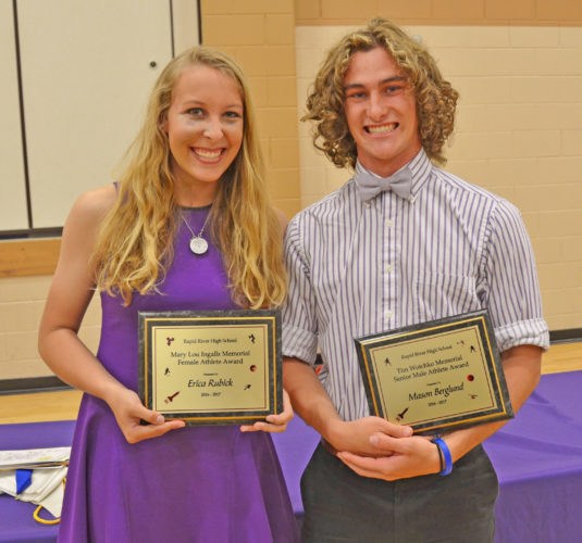 Courtesy photo Rapid River High School recently honored seniors Erica Rubick and Mason Berglund. Rubick was presented with the Mary Lou Ingalls Memorial Female Athlete Award. She earned 17 varsity letters (3 volleyball, 2 cross country, 4 basketball, 4 track and field, 4 softball). Berglund was presented with the Tim Wotchko Memorial Male Athlete Award.  He earned 14 varsity letters (4 football, 4 track and field, 2 cross country, 4 basketball).