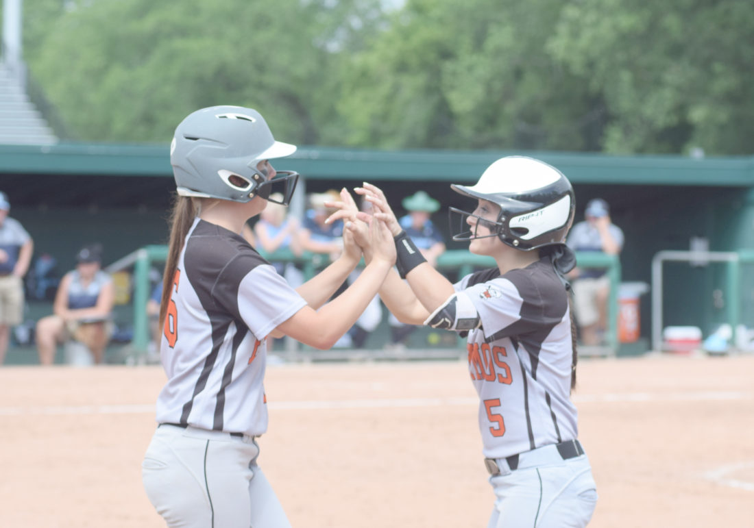 Mike Mattson | Daily Press Escanaba courtesy runner Cassie Wisler, left, congratulates Taylor Segorski after her base hit in the sixth inning.
