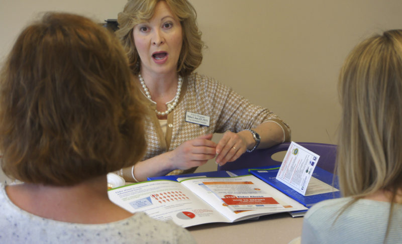 In this May 4, 2017 photo, Melissa Jones, center, a nurse educator with Alosa Health, speaks with social worker Jean Easter, left, and physician's assistant Emily Braunegg in the lunch room of a medical office in Monroeville, Pa. Jones visits medical offices in western Pennsylvania, to educate doctors and their teams about new opioid prescribing guidelines. (AP Photo/Carla K. Johnson)