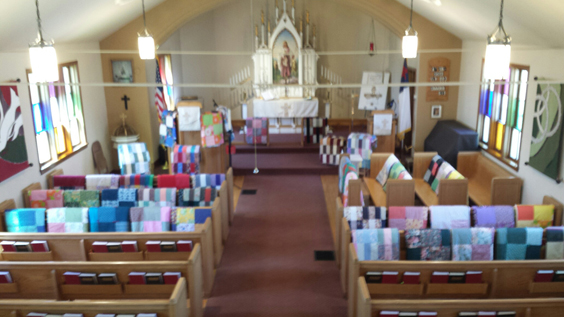 Courtesy photo A beautiful array of quilts were spread across the sanctuary pews again this year at Trinity Lutheran Church of Stonington. On Mother's Day, these quilts received a special blessing from Pastor Diane Srutowski to send them on their way to bring warmth, comfort and inspiration to local organizations. This year, the quilts were donated to local residents who were ill, Hope at the Inn, and the Bay Pines facility. After the Mother's Day services, the ladies held a pie social to raise funds. Every week the Monday Morning Quilters gather at 9 a.m. to design, sew and lovingly finish each quilt. Members of the group are Carol Mosher, Ann Hager, Eleanor Weycker, Ginny Dahlin, Sandy Williams, Mary Lachat, Sharon Bigelis, Mary Holewinski, Barb Constantino, Kathy Nachtwey and Pastor Diane Srutowski. Everyone is welcome to participate. Donations of 100 percent cotton fabric are always needed. For a donation, questions or further information, contact Pastor Diane Srutowski at dsrutowski@gmail.com or visit www.tlcstonington.com.