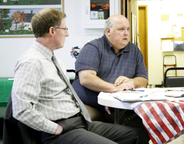 Jenny Lancour | Daily Press Escanaba City Manager Jim O'Toole, at right, discusses development of a marketing plan for the Superior Trade Zone (STZ) Tuesday at Maple Ridge Township Hall in Rock. Also pictured is STZ Chair Scott Erbisch, Marquette County administrator.