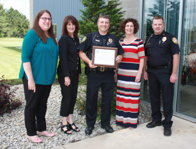 Jenny Lancour | Daily Press Escanaba Public Safety receives special recognition for educating the public on the safe use of child car seats and providing low-cost car seats to families. Pictured at Wednesday's award presentation in Escanaba are, from left, Michigan Office of Highway Safety Planning representatives Diane Curry and Jamie Dolan and Escanaba Public Safety representatives Lt. John Gudwer, Administrative Assistant Jennifer Spriks, and Director Rob LaMarche.