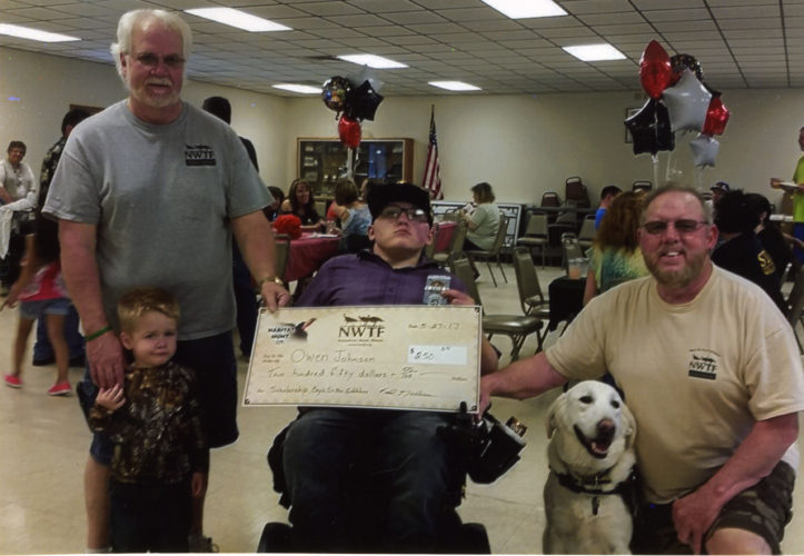 Courtesy photo Owen Johnson and his service dog Cooper, were paid a surprise visit by the Bay's de Noc Gobblers at his graduation party. He was awarded the Robert (Bob) Miller Wheelin' Sportsmen's Memorial Scholarship for $250, along with a 2017 successful turkey hunters patch. Owen harvested a nice bird hunting with the Wheelin' Sportsmen. Pictured, left, Fred Nordman and his grandson Charlie, Owen and Cooper, and Ken Buchholtz.