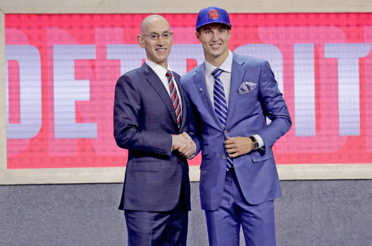 Duke's Luke Kennard poses for photos with NBA Commissioner Adam Silver after being selected by the Detroit Pistons as the 12th pick overall during the NBA basketball draft Thursday in New York.