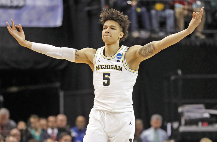 AP file photo Michigan's D.J. Wilson was chosen by the Milwaukee Bucks in Thursday's NBA draft.