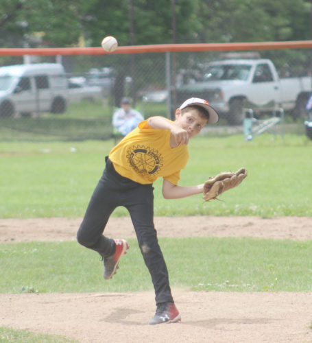 Avery Bundgaard | Daily Press Cannon Arndt delivers a pitch for Escanaba against Kingsford during the Yooper 9-10 Little League tournament Sunday. Escanaba lost to Kingsford 7-4. In other games Sunday, Negaunee defeated Gladstone 13-10 and Iron Mountain defeated Marquette 10-0. In today's semifinals, Norway will face Negaunee in the first game at 5 p.m. and Iron Mountain will take on Kingsford at 7 p.m. in the other semifinal game at Escanaba's Karl Dickson Field. The championship game is scheduled for Tuesday at 6 p.m. at Escanaba.