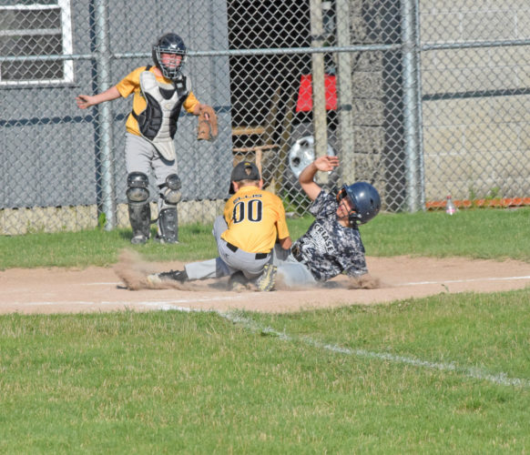 Mike Mattson | Daily Press Iron Mountain's Aiden Ellis, left, applies a tag at home plate on Norway's  Landon Amundson after catching the ball from catcher Jake Powell (background). Iron Mountain defeated Norway 13-12 in the finals of the Yooper 9-10 Little League Tournament at Escanaba's Karl Dickson Field.