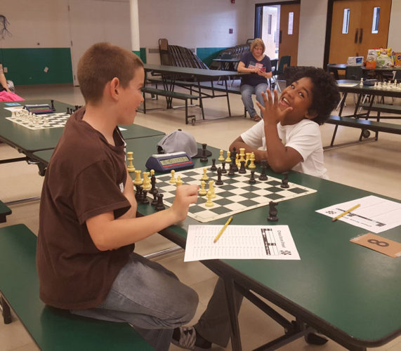 Courtesy photo Conor Fee, left, and Freddie Shaw face off during a chess tournament at Holy Name Catholic School on June 3. This was the first tournament held by a new Holy Name-based chess club.