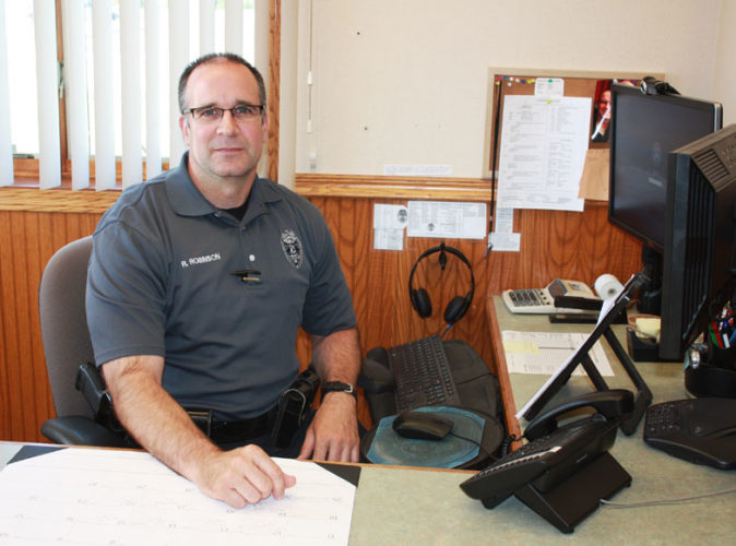 Jenny Lancour | Daily Press Ron Robinson, pictured above, is the newly-hired director at Gladstone Public Safety. The former Gladstone officer and detective replaces Paul Geyer, who served 24 and a half years at the police department including 11 years as director.