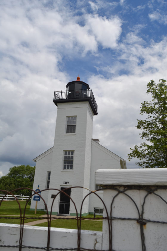 Courtesy photo Shown is the Sand Point Lighthouse on a cloudy afternoon. To celebrate the 150th birthday, a special event is being held on Monday, July 3 at 1:30 p.m. Admission is free.