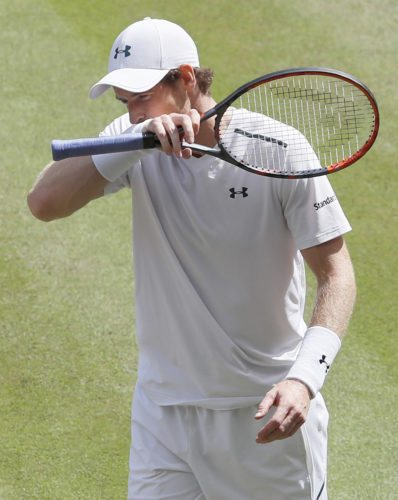 AP photo Britain's Andy Murray wipes his face as he plays his Men's Singles Quarterfinal Match against Sam Querrey of the United States on day nine of Wimbledon in London Wednesday.