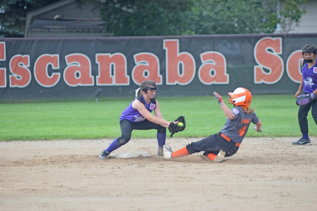 Mike Mattson   Daily Press Gladstone shortstop Rylee Gerow gets ready to apply a tag on Escanaba's Katie Lamb in Thursday's Little League Major Girls game at Lemerand Park. Lamb was caught stealing on the play.