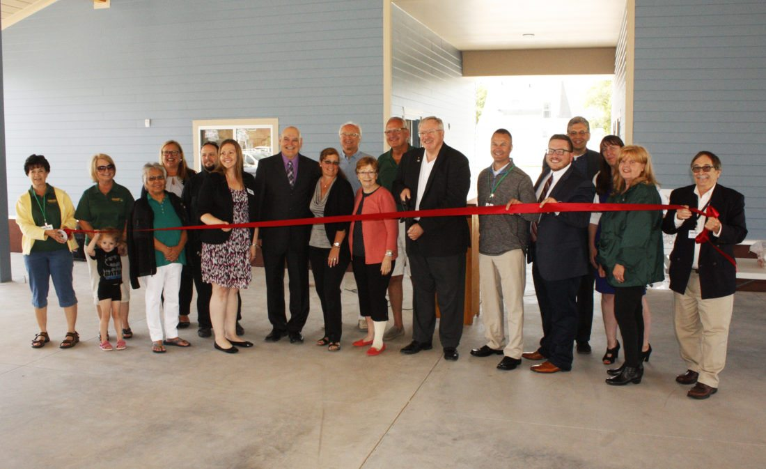 Jenny Lancour | Daily Press Members of the Escanaba Downtown Development Authority, the Delta County Ambassadors, political representatives, the architect, and financial supporters of Escanaba's new marketplace participate in a ribbon-cutting ceremony Friday.