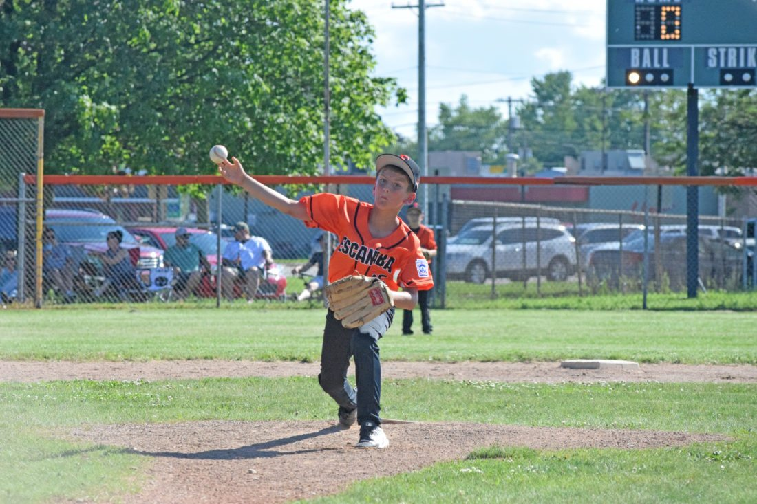 Mike Mattson | Daily Press Escanaba pitcher Lennox Peacock delivers to the plate against Gladstone Friday in the District 10 Little League Minor Boys All-Stars opener at Dickson Field.