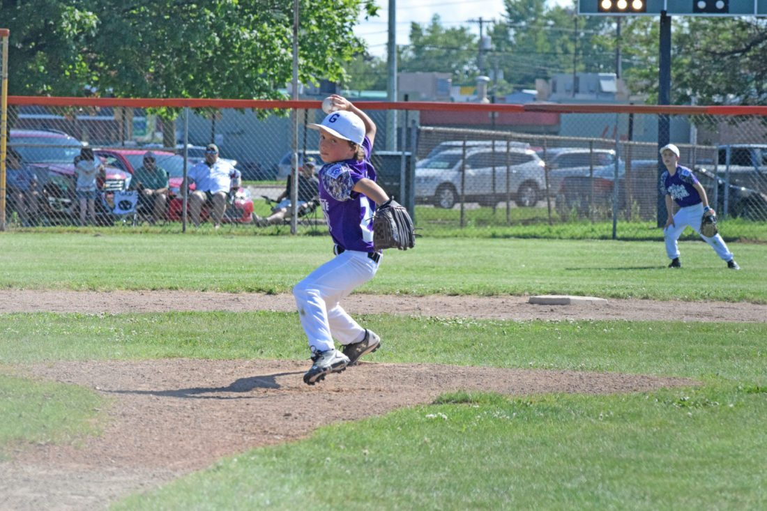 Mike Mattson | Daily Press Gladstone pitcher Cooper Sanville focuses on the strike zone against Escanaba in Friday's District 10 Little League Minor Boys All-Star game at Dickson Field.