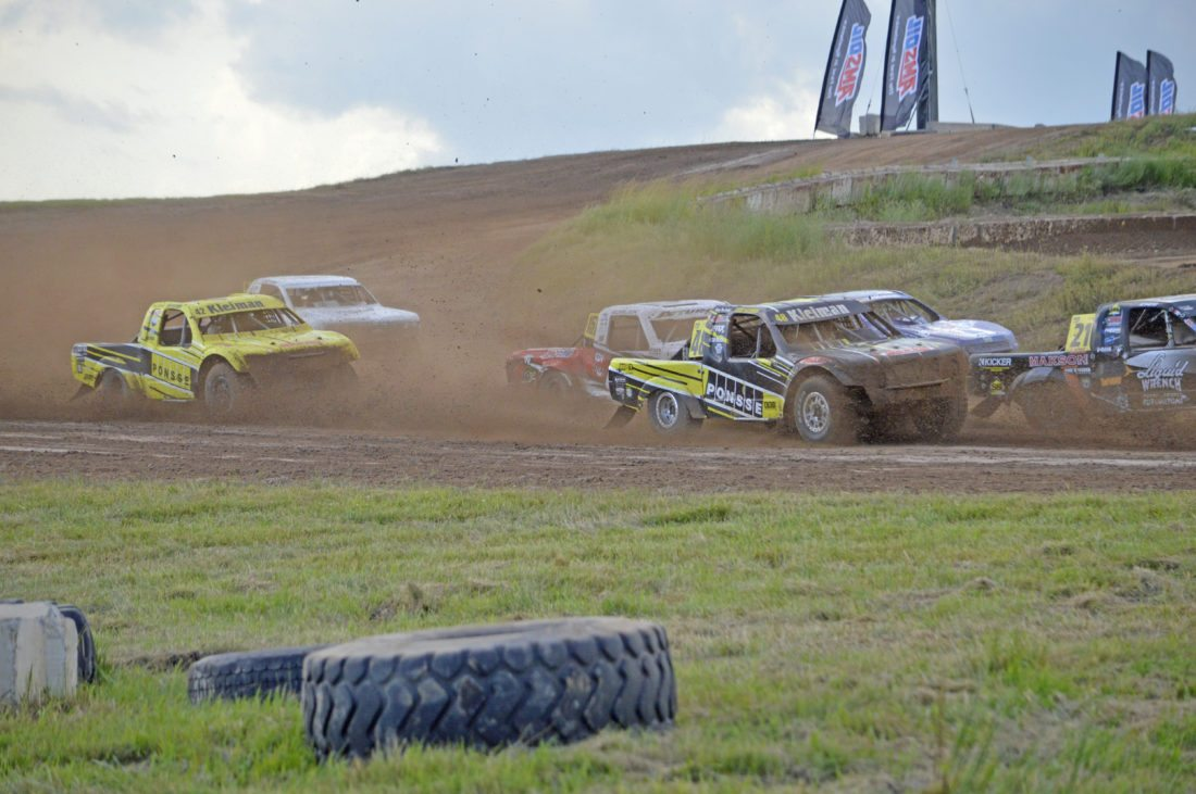 Ilsa Matthes | Daily Press Cody Kleiman (48) leads his brother Kyle Kleiman (42) around a corner in Sunday's Upper Peninsula Off-Road 100 at Bark River International Raceway. Cody won the Pro Light event Sunday and was runner-up to Kyle in Saturday's TORC Series race.