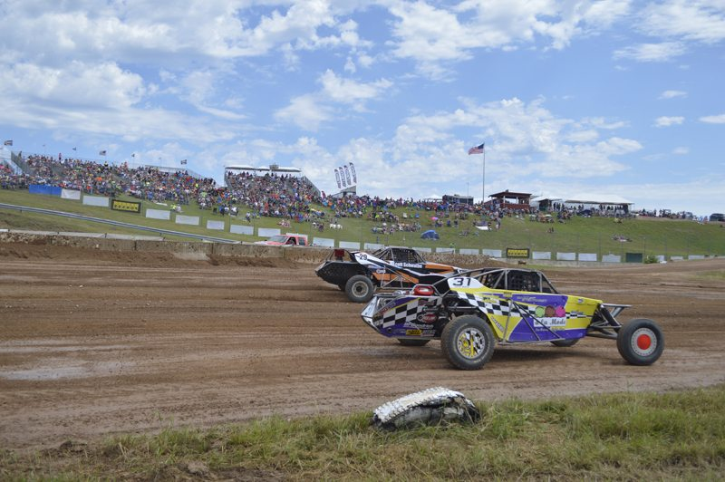 Ilsa Matthes | Daily Press The Bark River Off-Road Race were in full swing this weekend. Above, racers in the super buggy class are neck and neck as they make their way around the track as fans look on.