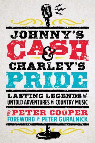 "This cover image released by Spring House Press shows ""Johnny's Cash & Charley's Pride: Lasting Legends and Untold Adventures in Country Music"" by Peter Cooper. (Spring House Press via AP)"
