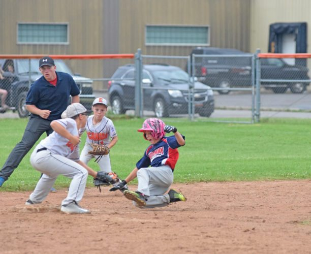 Mike Mattson | Daily Press Norway's Ian Popp slides into second base as Escanaba's Bon LaChance applies the tag and teammate Eli Gardner looks on. Popp was called out by umpire Johnny Schlenvogt on the play in the top of the fourth inning of the District 10 Little League 11U All-Stars game at Dickson Field.