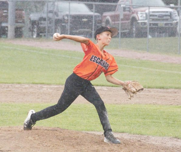 Adam Niemi | Iron Mountain Daily News Escanaba's Lennox Peacock delivers a pitch against Norway Tuesday at Norway during the Little League Minors District 10 tournament.