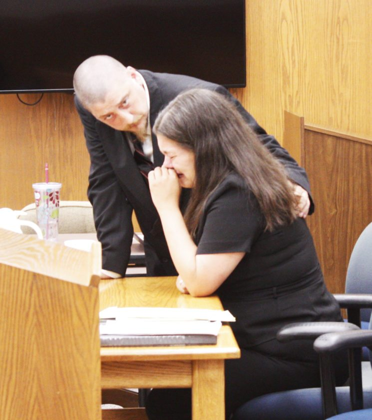 Jenny Lancour | Daily Press Tammy Fryer is consoled by her boyfriend, Michael Lavoie, following Fryer's questioning at the couple's parental rights trial in Delta County Probate Court on Tuesday.