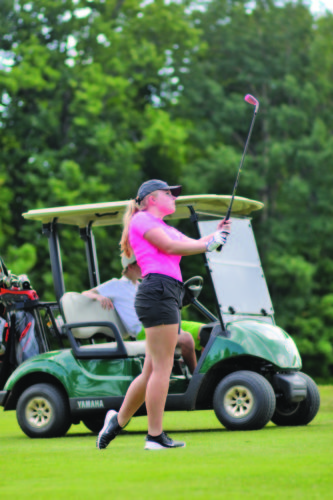 Rachel Oakley | Mining Journal Paxton Johnson of Escanaba chips on the fairway during day 3 of the Upper Peninsula Ladies Golf Association annual tournament at the Marquette Golf Club Tuesday afternoon.