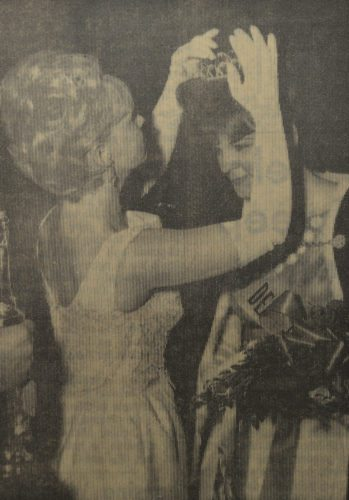 Daily Press photos Miss Delta County of 1965 Sandra Maki, at left, passes her crown and title to Cherie Anne Maskart, who was chosen 1966 Queen that day at the Area High School. Both resided in Gladstone.