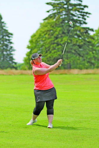 Rachel Oakley | Journal photo  Kendra Anderson chips on the fairway during the final day of the Upper Peninsula Ladies Golf Association annual tournament at the Marquette Golf Club Wednesday afternoon.