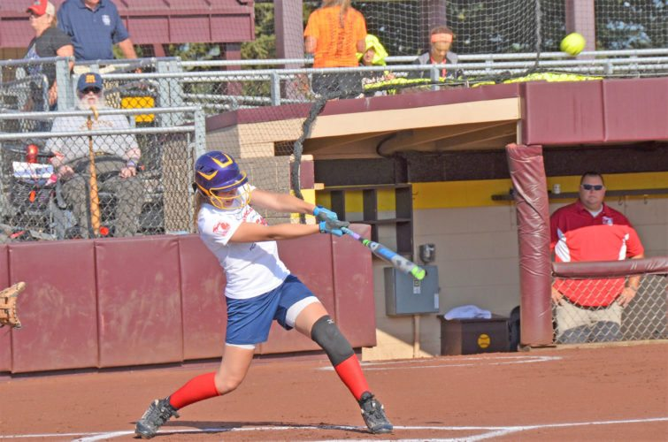 Courtesy photo Rapid River's Erica Rubick connects on a hit Wednesday in the Division 4 Michigan High School Softball Coaches Association All-Star Game at Central Michigan University's Margo Jonker Stadium. Rubick went 4-for-4 with a double and four RBIs to help the White Team to a 14-6 victory.