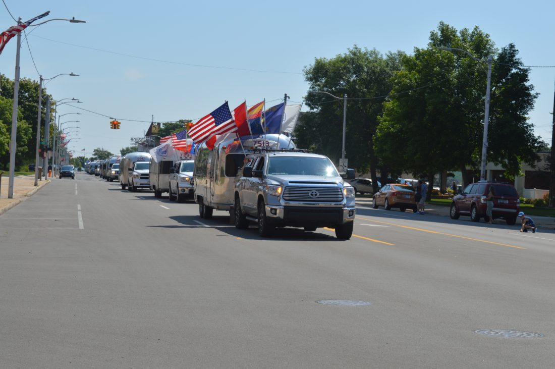 Haley Gustafson | Daily Press  Airstream campers cruise down Ludington Street Thursday afternoon during the Wally Byam Caravan Club International (WBCCI) parade in Escanaba.