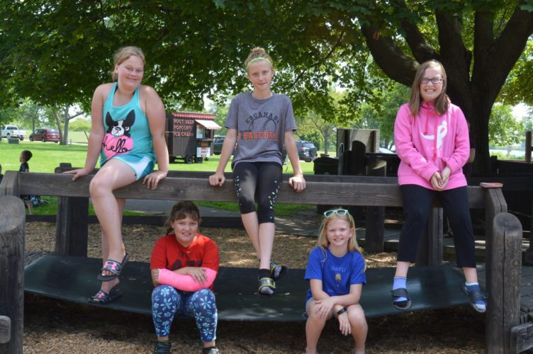 Haley Gustafson | Daily Press  Salvation Army Day Camp participants take a break from playing at Harbor Hide Out in Escanaba Tuesday, July 18. Shown in back from left are, Zoey Harris, Anna Boutilier, and Lily Beauchamp. In front from left are Lily Germain and Bayli Short.