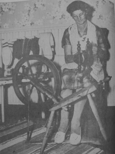 "Daily Press photo In this Remember When photo, the headline above in the original publication in the October 1953 Escanaba Daily Press read ""From Sheep To Socks is a Good Trick If You Can Do It; Mrs. Martin Can."" Mrs. Cy Martin of Bark River, wove wool on her antique spinning wheel as her winter hobby. Her mother, August Porath, taught her how to turn wool into clothes on the spinning wheel, which then was over 50 years old. Mrs. Martin lived on a farm in Bark River with her husband, who is referred to as Mr. Martin in the article, for 47 years raising four children: three daughters and a son."