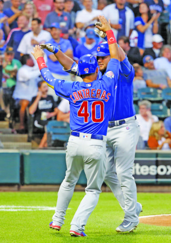 AP photo Cubs' Kyle Schwarber, right, and Willson Contreras celebrate after they scored on Schwarber's two-run home run off Chicago White Sox starting pitcher Mike Pelfrey during the fourth inning Thursday in Chicago.