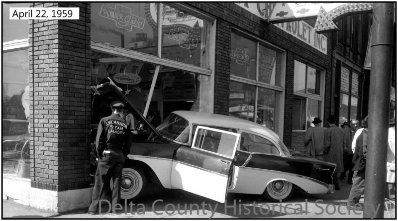 Photo from Delta County Historical Society Shown is an accident with a newly purchased automobile from April 1959. This photograph is just one in the Bernie Schultz Collection.