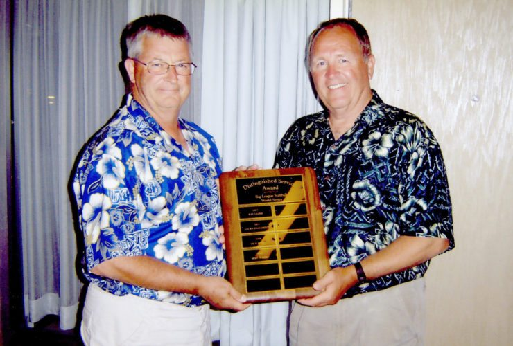 Courtesy photo Dick Rusha, left, and Mike Gobert, accept a Distinguished Service Award at the 2008 Little League Girls Big League World Series in Kalamazoo.