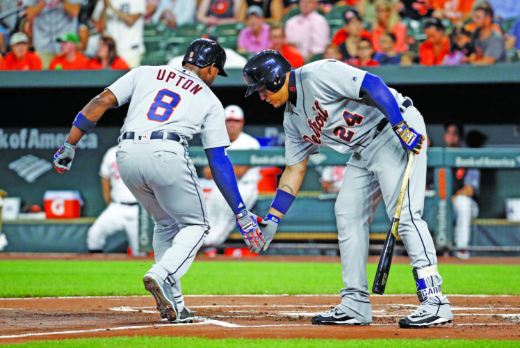 AP photo Detroit's Justin Upton, left, celebrates his solo home run Thursday with teammate Miguel Cabrera as he crosses home plate in the first inning against Baltimore.