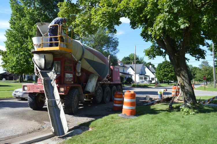Haley Gustafson   Daily Press  Escanaba Public Works Department employees work on curb repairs recently on a portion of Ogden Avenue in Escanaba. Throughout the summer, various curb and repaving projects are slated throughout Escanaba on local and major roadways.