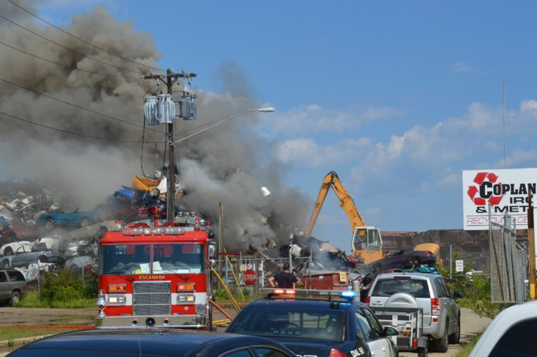 Haley Gustafson   Daily Press Black smoke rises off a pile of cars at Coplan Iron & Metal Co. The salvage yard lit fire shortly after 3:30 p.m. Monday.