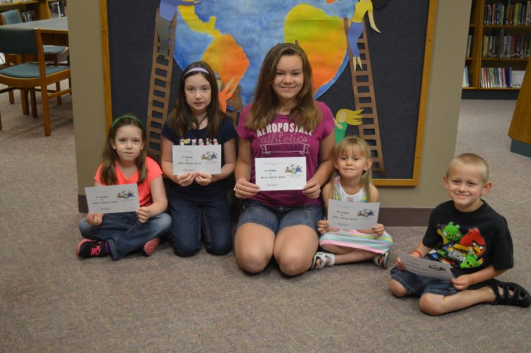"Haley Gustafson | Daily Press  Escanaba Summer Reading Program participants show off their completion certificates at the Escanaba Public Library recently. Over the course of the summer, kids ages 4 and up from around the area participated in the six-week program that held the theme ""Build A Better World."" Upon completion of many activities and reading, the kids received prizes such as a certificate of achievement, Pizza Hut coupons, cash prizes and a goodie bag. Shown from left are summer readers Kenzie Jorasz, Zoey Jorasz, Brianna Tervo, Kelsey Ekberg and David Ekberg."