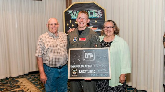 Courtesy photo 2nd Lt. Trevor Birr received his Air Force pilot wings during the Specialized Undergraduate Pilot Training Class 17-12 graduation July 28 at Vance Air Force Base, Oklahoma. He will continue his military flying career as an instructor pilot in the T-6A Texan II. Pictured with Birr are his parents, Bruce and Rae Birr.