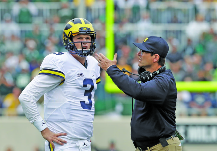 AP photo In this file photo, Michigan head coach Jim Harbaugh talks with quarterback Wilton Speight (3) during the first half of a game against Michigan State. Harbaugh has won on and off the field in two years at Michigan, posting a pair 10-3 seasons and generating a lot of publicity with his outside-the-box ways. The Wolverines, though, have finished third in the Big Ten's East Division in each of the last two years and only time will tell if Harbaugh's sizzling style will lead to championships.