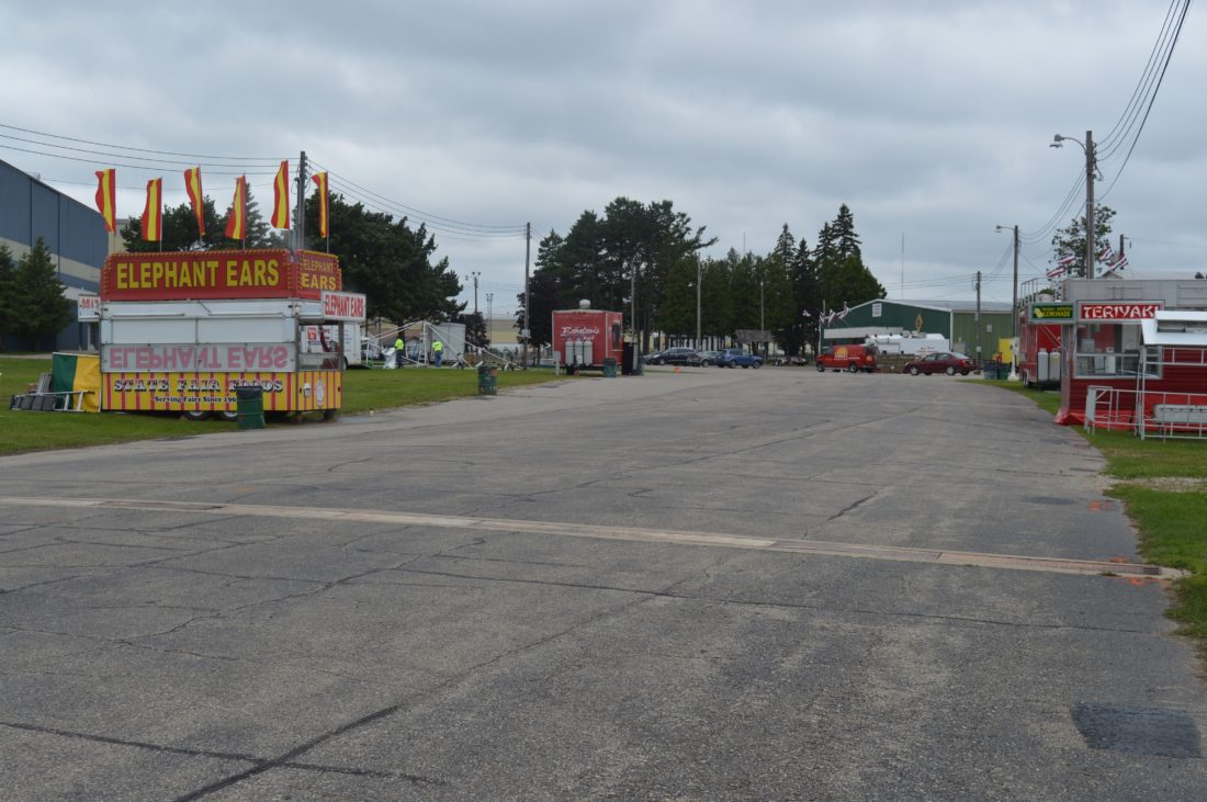 Haley Gustafson | Daily Press  Food vendors begin to line the midway at the Upper Peninsula State Fairgrounds in Escanaba Friday afternoon. The fairgrounds will soon be bustling with people and a wide variety of activities as the U.P. State Fair returns Monday and continuing until Aug. 20.