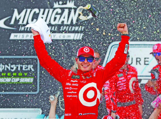AP photo Kyle Larson celebrates winning the NASCAR Cup Series auto race in Brooklyn, Mich., Sunday.