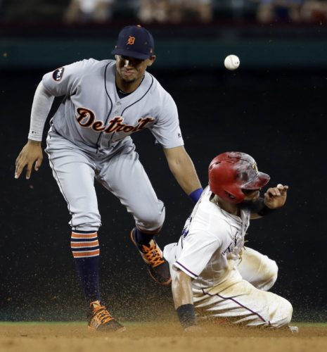 AP photo Detroit Tigers shortstop Dixon Machado is unable to catch the throw to the bag as Texas Rangers' Rougned Odor steals second in the sixth inning  Monday in Arlington, Texas.