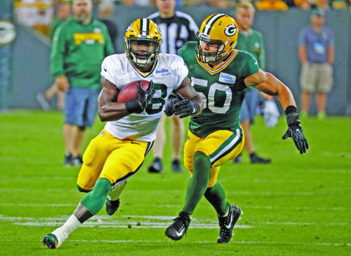 AP photo In this file photo, Green Bay's Ty Montgomery (88) makes a catch while being covered by Blake Martinez (50) during a training camp practice in Green Bay. Montgomery is getting much more attention this year in camp by virtue of his expanded role on a potent offense.