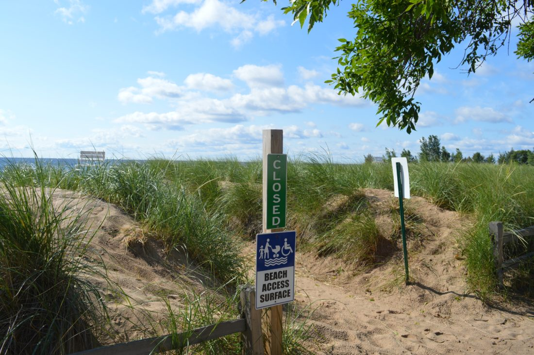 Haley Gustafson | Daily Press  Shown above is a sign notifying residents that the Escanaba beach is now closed. The beach and Webster Wading Pool closed for the season over the weekend due to lack of lifeguards, as most are college-bound and are heading back to school.