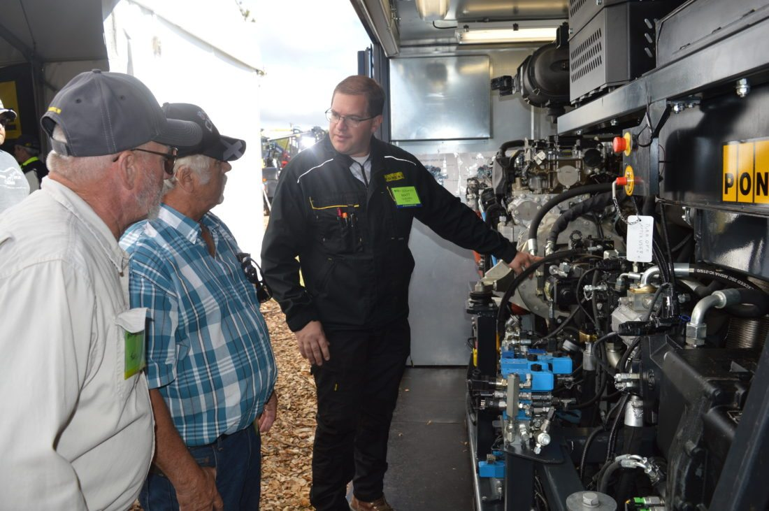 Jordan Beck | Daily Press From right, Ponsse Service Trainer Matt Godard shows Ponsse's new service training center to Great Lakes Logging and Heavy Equipment Expo attendees John Zupon and Ken Hetto Friday.